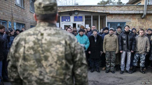 Conscripts attend a ceremony marking their enrolment in the Ukrainian army in Kiev on 29 January 2015