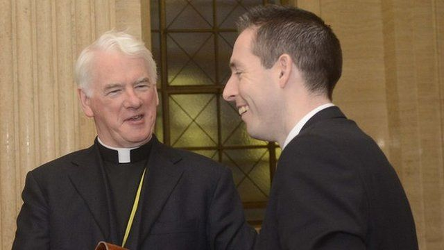 Bishop of Down and Connor Noel Treanor and DUP MLA Paul Givan