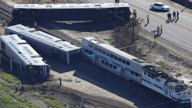 Dozens of people have been injured in the collision between a truck and a train