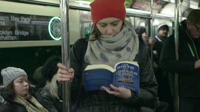 Woman reading on subway