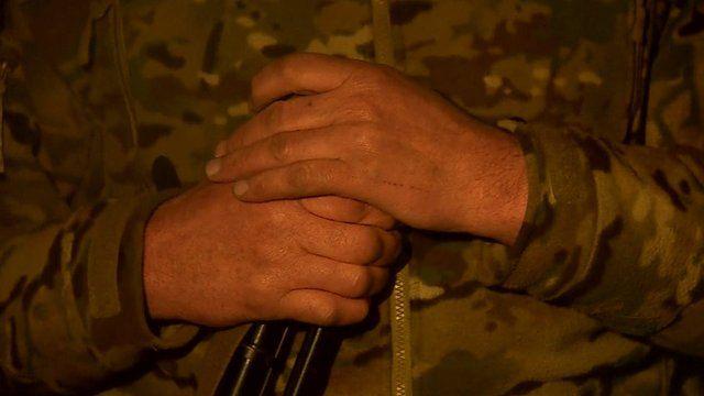 Milita man holds gun in Donetsk