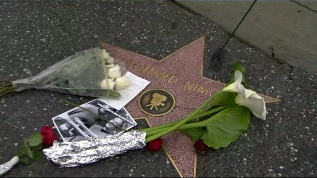 Close up of Leonard Nimoy's Hollywood star in Los Angeles with tribute flowers and photograph on it