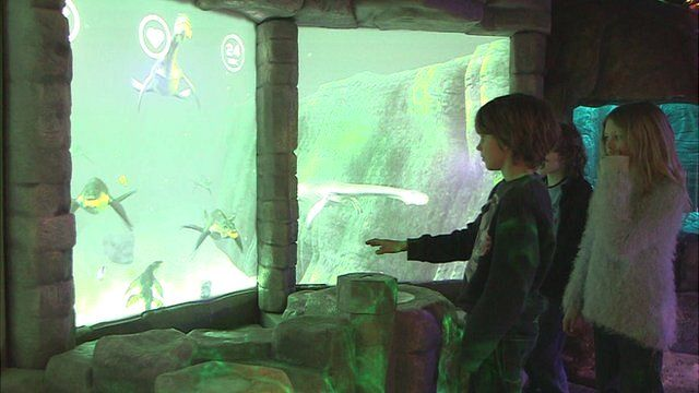 Kids playing with the new Jurassic exhibit at the Sealife centre
