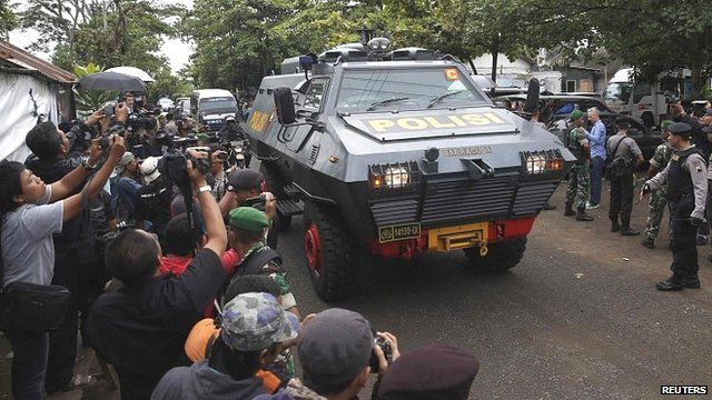 Police vehicle believed to be carrying two Australian prisoners, arrives at the port to take a ferry to the prison island of Nusa Kambangan