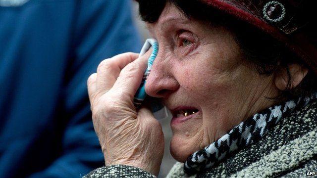 Valentina Dzuba, 72, mother of a miner, cries outside the Zasyadko mine in Donetsk