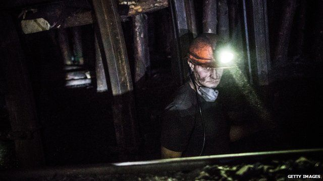A coal miner works over 3,600 feet below the surface of the earth at Scheglovka Glubokaya mine on March 3, 2015 in Makeevka, Ukraine.