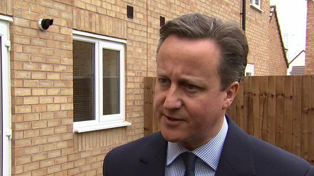 Prime Minister David Cameron speaking to the media while visiting a house building project in Cannock