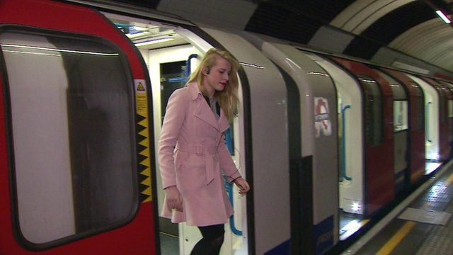 Woman steps off a tube train