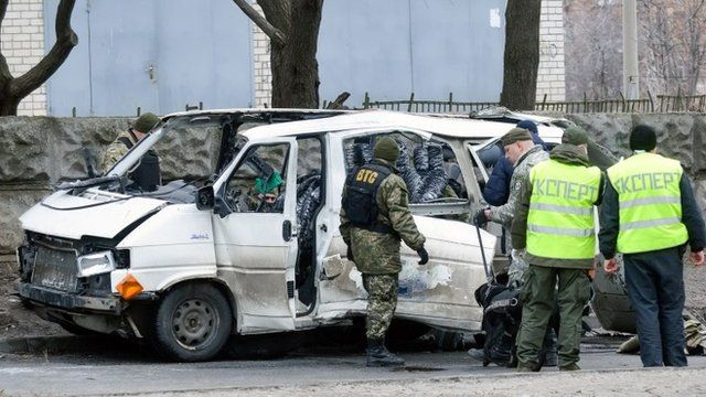 Wreckage of a minibus in Kharkiv