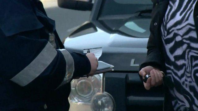 Parking warden issues ticket in Leeds