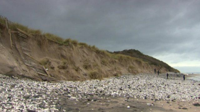The RNLI has warned the public to stay away from the sand cliff edges and bases, as Andy West reports