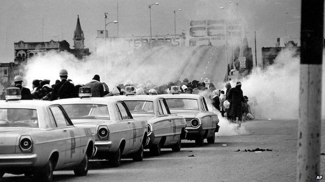 Tear gas fumes fill the air as state troopers break up a demonstration march in Selma, Alabama on 7 March 1965