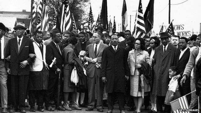 Civil rights campaigner Dr Martin Luther King (C) with his wife Coretta Scott King, at a black voting rights march in Selma in March 1965