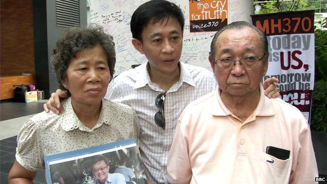 Wong Siew Lian (R) with her son Daniel Tan and husband Tan Tuan Kee (R). Their son and brother Tan Chong Ling was on board MH370