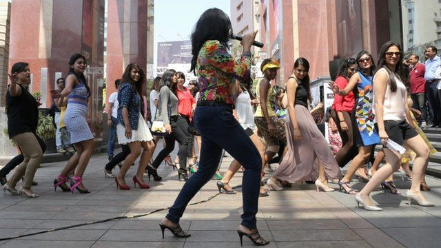 "Women warm up their ankles prior to taking part in India's first ever ""Stiletto Run"""