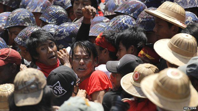 Student protesters fight with police while trying to break a police line in Letpadan