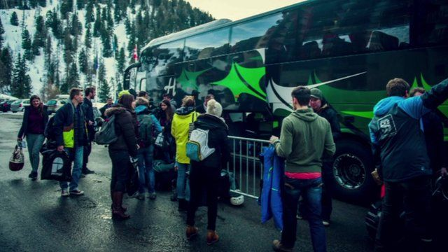 Coach arrived in the alps with tourists outside