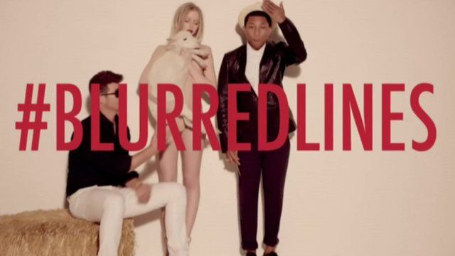 Robin Thicke and Pharrell Williams in Blurred Lines video