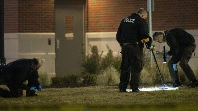 Investigators at the scene of the shooting
