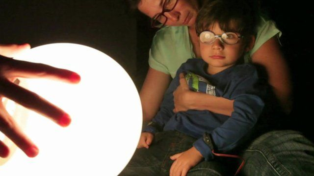 A child looking at a light