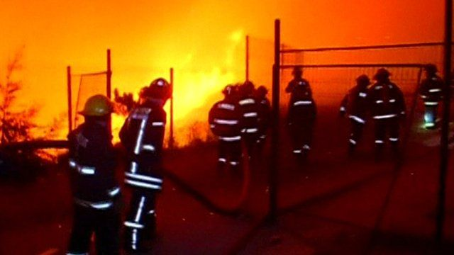 Fire fighters tackle the blaze in Chile