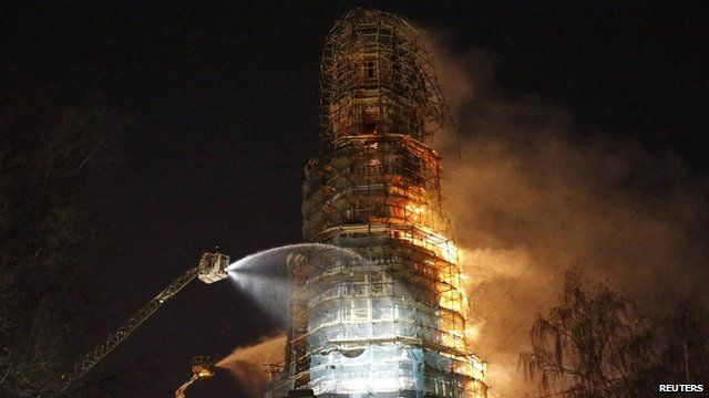 Firefighters work to extinguish a fire at the bell tower of Novodevichy monastery in Moscow on 15 March 2015