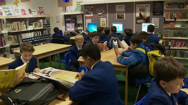 School pupils in library