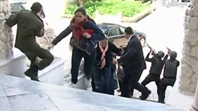 Image taken from video shows tourists running for cover as armed men stand guard at Tunisia's national museum in Tunis