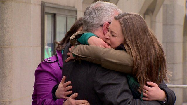 Family of Sun former deputy editor Fergus Shanahan hugging him after he emerges from the Old Bailey after being cleared of paying public officials for stories