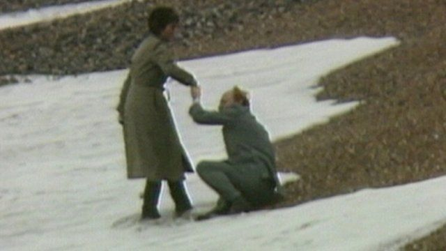Neil Kinnock's election as Labour leader is overshadowed by a fall on Brighton beach