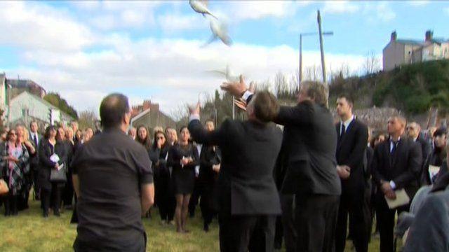 Doves released at Rhodri Miller's funeral