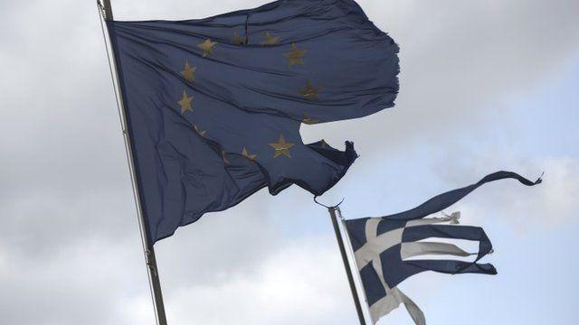 Ruined EU and Greek flags