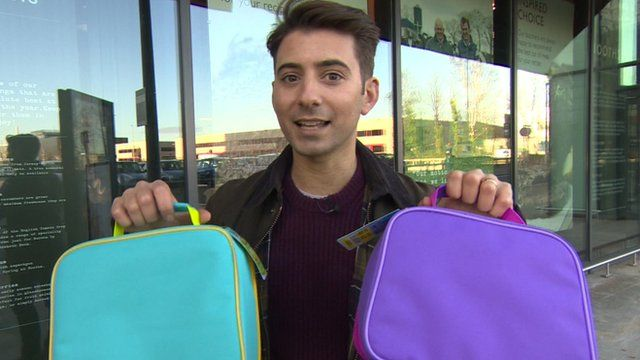 Ricky holding two packed lunch boxes