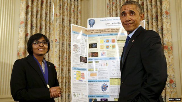 Obama talking to one of the exhibitors