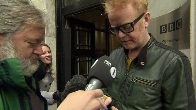 Chris Evans talking to reporter