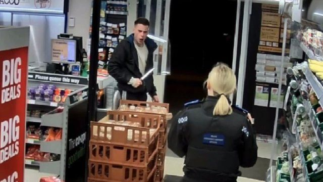 James Lewis wielding a knife at a PCSO officer during the attempted robbery
