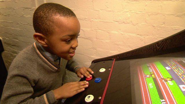 William plays arcade game