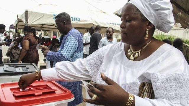 A woman casts her ballot at a polling station in Lagos