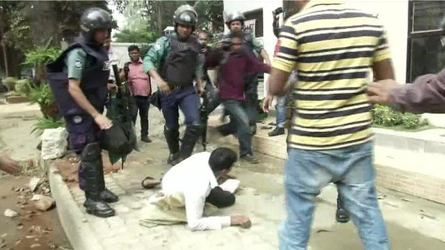 Riot police with protesters in Bangladesh