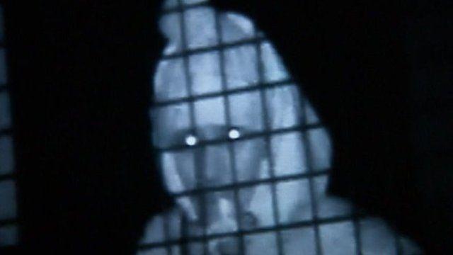 CCTV image of man attacking gas cylinder