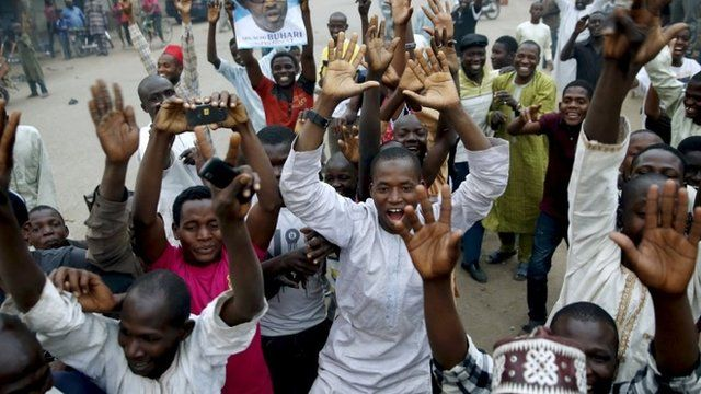 Supporters of the presidential candidate Muhammadu Buhari and his All Progressive Congress party celebrate in Kano