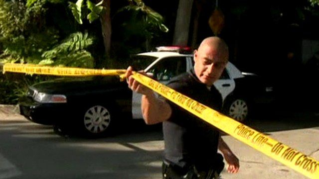 LAPD officer crosses police cordon