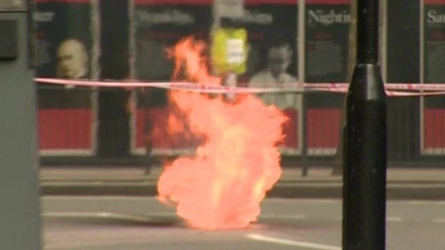 Plume of flame from under the ground in Holborn, London