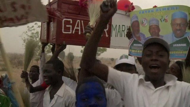 Gen. Buhari supporters holding a coffin symbolising the death of the previous government.