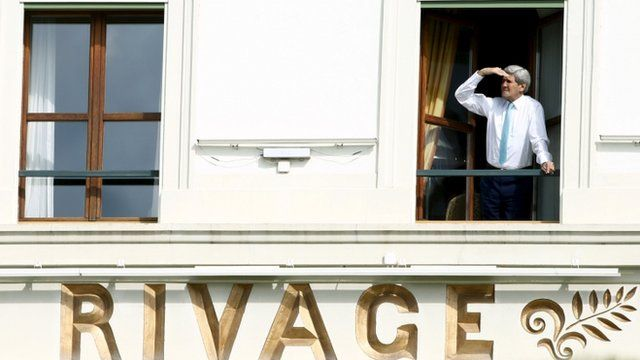 U.S. Secretary of State John Kerry looks out of his room at the Beau Rivage Palace Hotel during a break during the Iran nuclear program talks in Lausanne