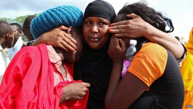 Some of the Garissa University students who were rescued comfort each other at the Garissa military camp, in Garissa town