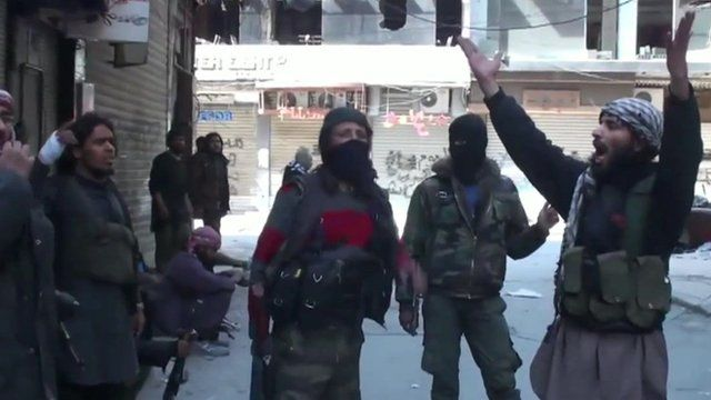 IS militants showing their victory in Yarmouk.