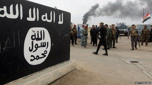 An Islamic State mural outside Tikrit