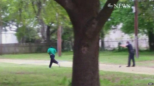 Still from footage apparently showing police officer shooting Walter Scott in the back