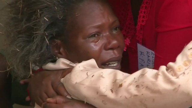 Relative of Garissa University victim crying as she is comforted by another woman